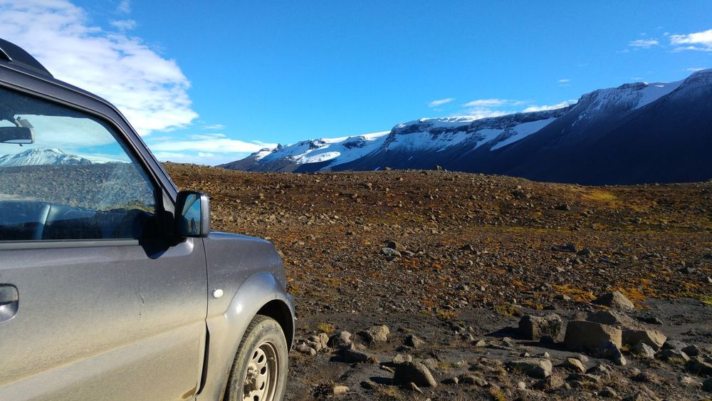 Car Land Vehicle Sky No People Scenics Landscape Mountain Snow Beauty In Nature Nature Outdoors Tranquility Mountain Range Snowcapped Mountain Iceland Wilderness Suzuki