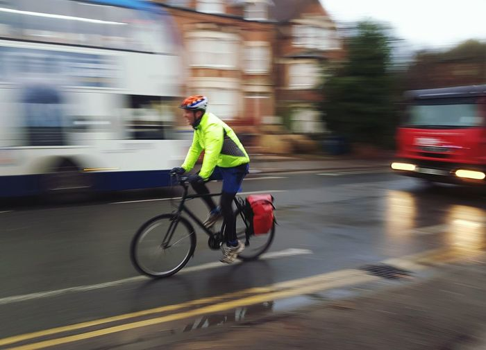 oxford's bicycle scenes Street_oxford Cycling Blurred Motion Bicycle Speed Headwear One Man Only Full Length Motion Transportation Safety Danger Mode Of Transport Sports Helmet Protection Fashion Stories Shades Of Winter Mobility In Mega Cities Stories From The City The Street Photographer - 2018 EyeEm Awards It's About The Journey British Culture