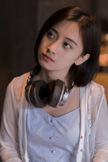 A music girl in a coffee bar. One Person Women Young Adult Young Women Indoors  Leisure Activity Real People Casual Clothing Hairstyle Portrait Front View Looking At Camera Lifestyles Holding Focus On Foreground Adult Waist Up Standing Beautiful Woman Hair Earphones Headphones Music