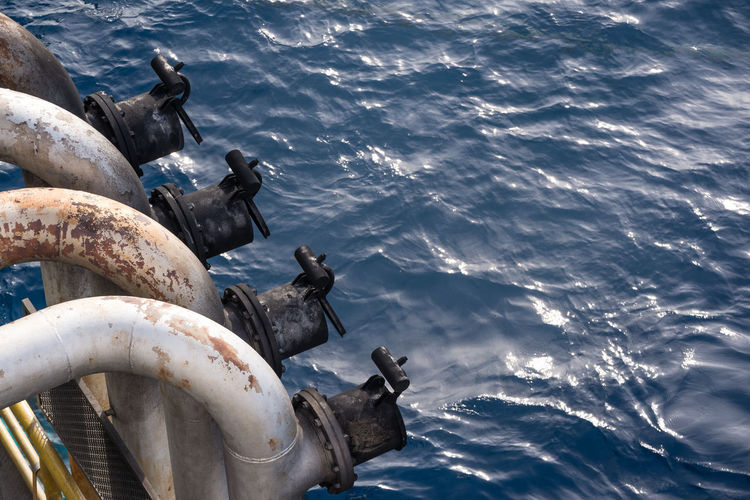 High Angle View Of Pipes Over Sea