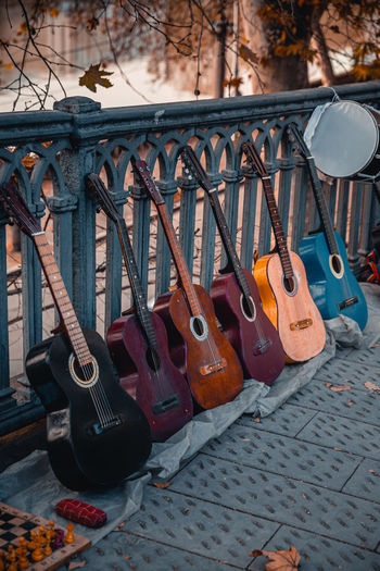 Close-up of guitar on street