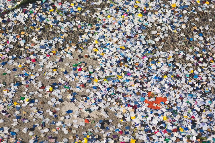 Full frame shot of multi colored confetti on field
