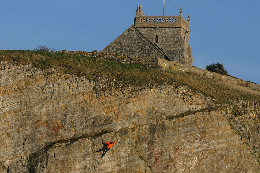 Adventure Architecture Built Structure Church Tower Cliff Day Extreme Sports History Leisure Activity Low Angle View One Person Outdoors Rock Climbing Somerset England UphillVillage