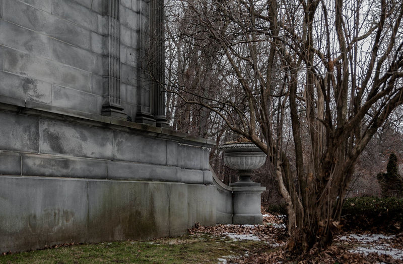 Abandoned Architecture Bare Trees Building Exterior Cemetary Crypt Death Exterior Grave Old Outdoors Outside Sculpture Stone Tomb Urn