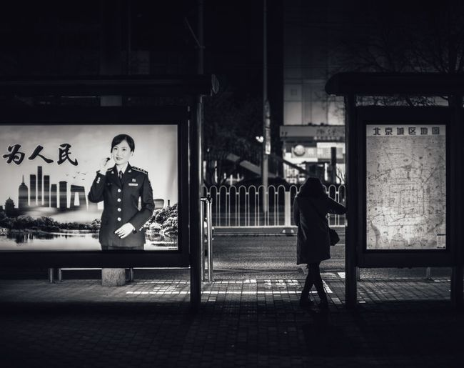 Men standing at night
