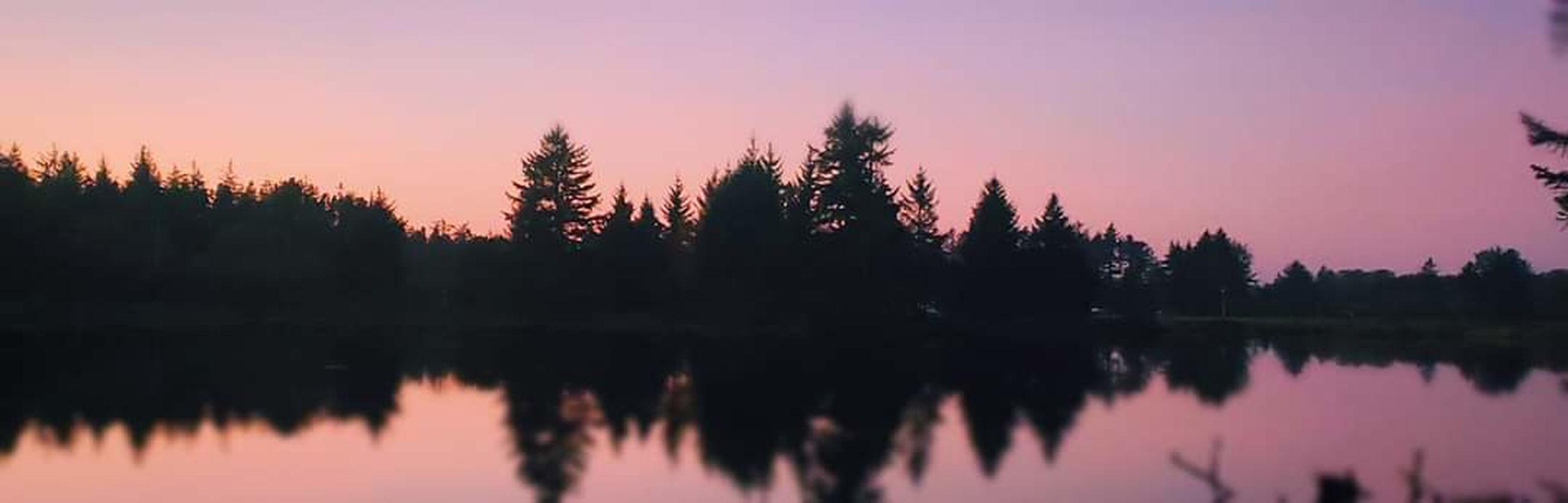 reflection, tranquility, beauty in nature, lake, water, tranquil scene, sunset, tree, sky, silhouette, scenics - nature, nature, plant, idyllic, no people, non-urban scene, orange color, outdoors, travel destinations, reflection lake, coniferous tree, purple