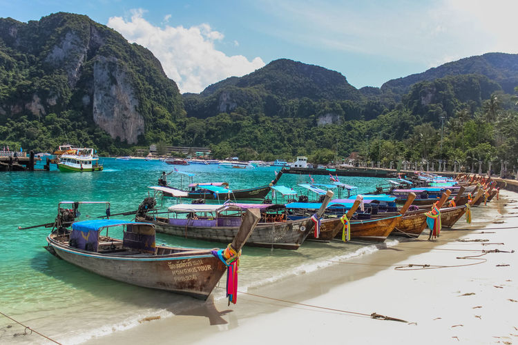 Other side of Phi Phi Don EyeEmNewHerе EyeEmNewHere. Beach Beauty In Nature Day Land Mode Of Transportation Moored Mountain Mountain Range Nature Nautical Vessel No People Non-urban Scene Outdoors Scenics - Nature Sea Sky Tranquility Transportation Water EyeEmNewHere