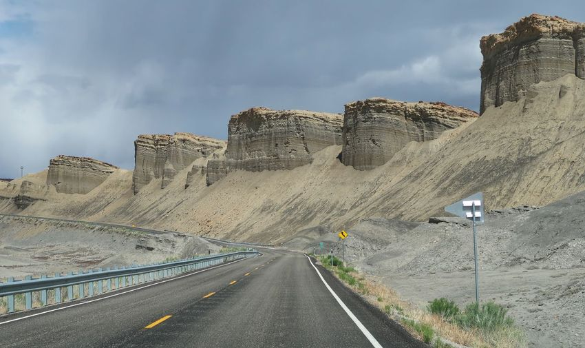 Bizarre grey rounded stone formations along a road in utah