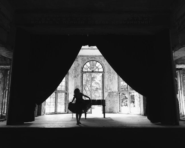 Silhouette woman dancing on abandoned stage