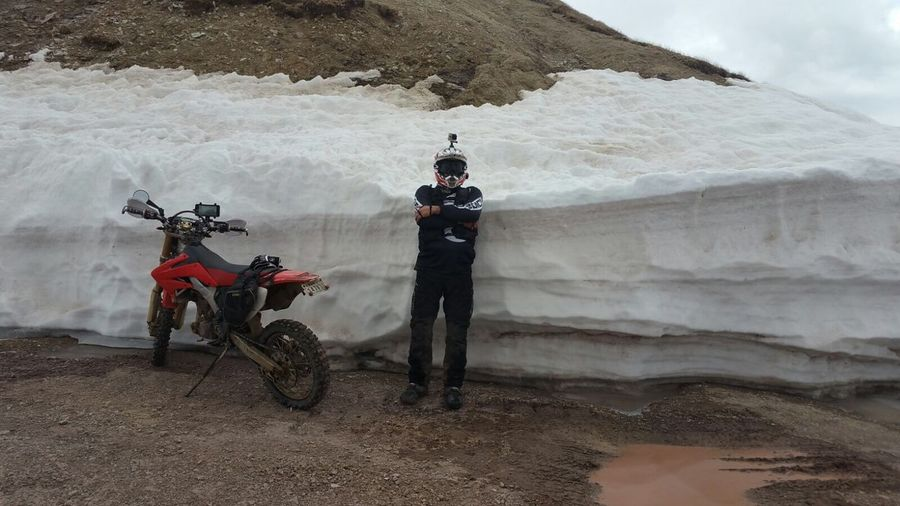 6ft Snow Bank Animas Forks, CO Snow Bank Snow Transportation Day Real People Full Length Nature Men Mode Of Transportation Motorcycle Outdoors