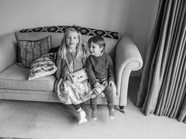 Weekend Childhood Child Girls Females Indoors  Women Full Length Furniture Family Togetherness Sibling Sister Sofa Two People Lifestyles Real People People Emotion Innocence Positive Emotion