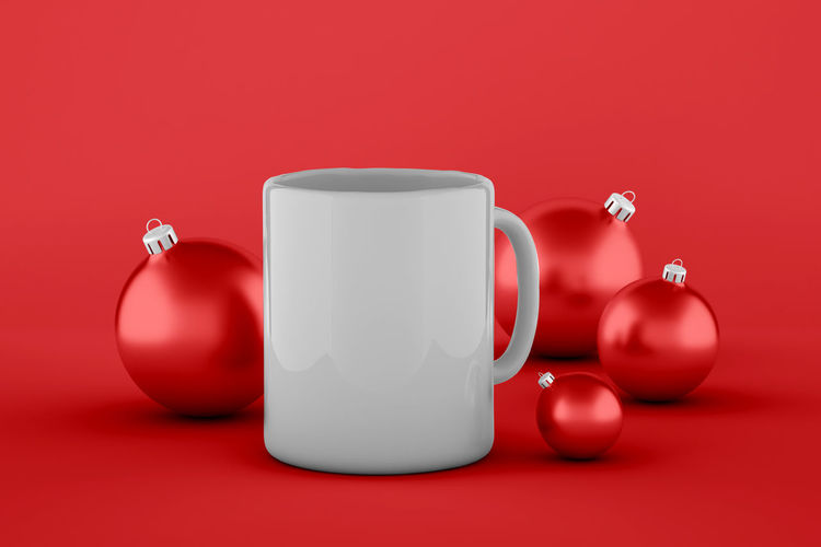 Close-up of tea cup on table against red background