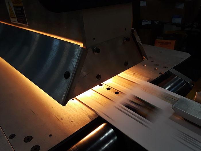 Close-up of glowing printing press