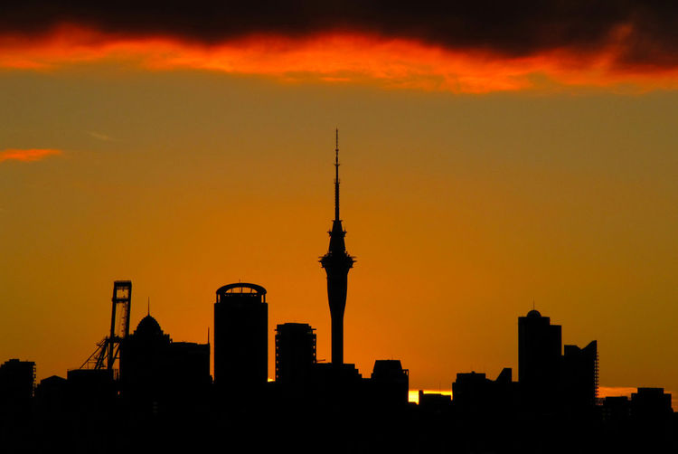 Auckland skyline at sunset Auckland Architecture Building Exterior Built Structure City Cityscape Communication Modern Nature No People Orange Color Outdoors Silhouette Sky Skyscraper Sunset Tower Travel Destinations Urban Skyline An Eye For Travel The Graphic City HUAWEI Photo Award: After Dark