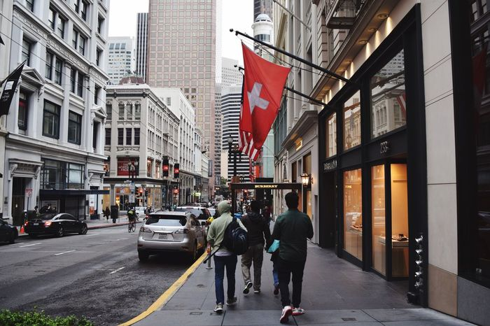 The Street Photographer - 2017 EyeEm Awards Architecture Building Exterior Built Structure City Street City Life Walking Day Car Real People Outdoors Flag Large Group Of People Road Transportation Men Land Vehicle Women Sky People EyeEmNewHere Sanfrancisco