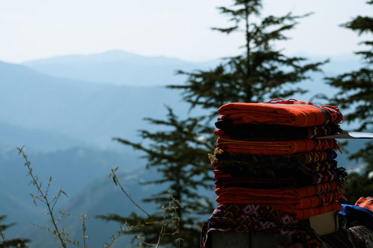 Close-up Clothes Day Focus On Foreground Mountain Nature No People Outdoors Sheets Sky Tree Warm Clothes Warm Clothing