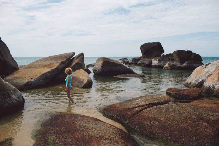 Curly Hair Girl Water Rock Solid Sea Rock - Object Sky Nature Scenics - Nature Beauty In Nature No People Day Tranquility Rock Formation Tranquil Scene Land Cloud - Sky Beach Outdoors Bird Stack Rock Marine