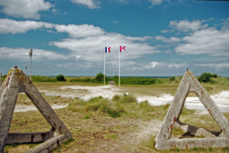 Normandie Normandie, France Beauty In Nature Cloud - Sky Communication Day Direction Environment Field Gold Beach Grass Land Landscape Nature No People Outdoors Plant Road Sign Sky Sword Beach Tranquil Scene Tranquility Transportation Wood - Material