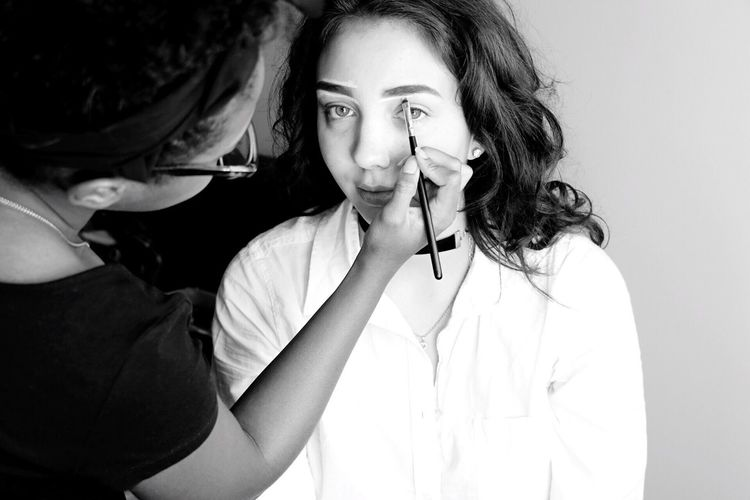 Makeup. Young Women Light Preparation  Makeup Friends People Moments Hanging Out Light And Shadow Portrait Taking Photos Check This Out Portrait Photography Black And White Blackandwhite Having Fun Monochrome The Portraitist - 2017 EyeEm Awards