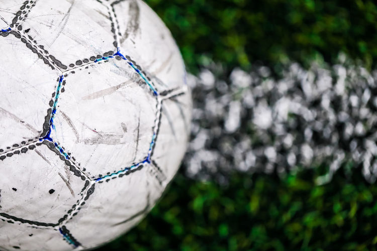 Ball Close-up Day Focus On Foreground Leisure Activity Midsection Nature No People Outdoors Pattern Plant Silver Colored Single Object Soccer Soccer Ball Sphere Sport Sports Equipment Team Sport White Color