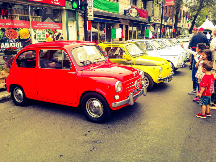 Cars Transportation Collection Mini Cars Little Italy red yellow White Color Colorful Spectators Public Urban Landscape People Watching Joyful Photoshopify! Festive Season Crowd