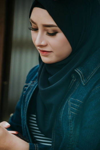 Close-up of beautiful young woman in hijab