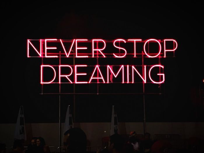 Dreams Night Text Neon Red Illuminated Retail  Large Group Of People Communication Lifestyles Women Outdoors Real People People Adult Neon Lights Neon Color Neon Sign