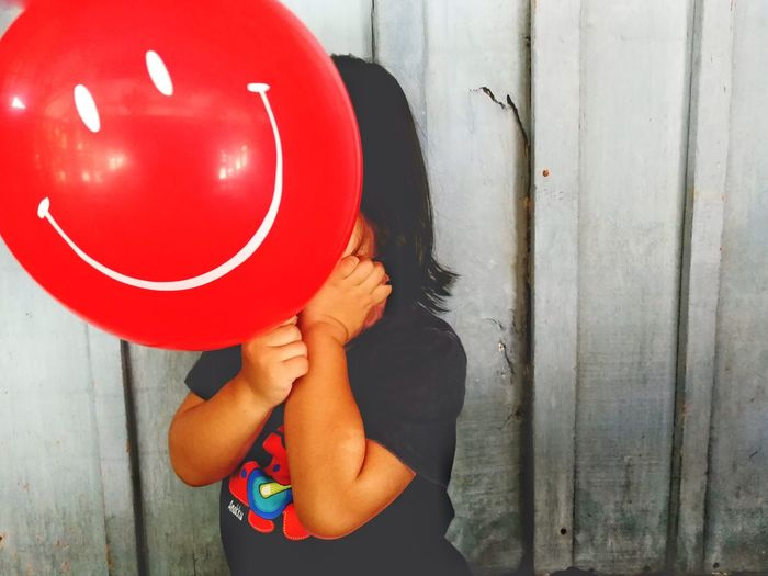 EyeEm Ready   One Person One Woman Only Only Women Red Adults Only Human Body Part Adult People Lifestyles Day Women Child Balloon Red Smile Human Hand Outdoors Low Section One Young Woman Only Close-up