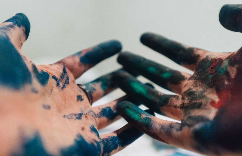 Close-Up Of Hands With Powder Paint