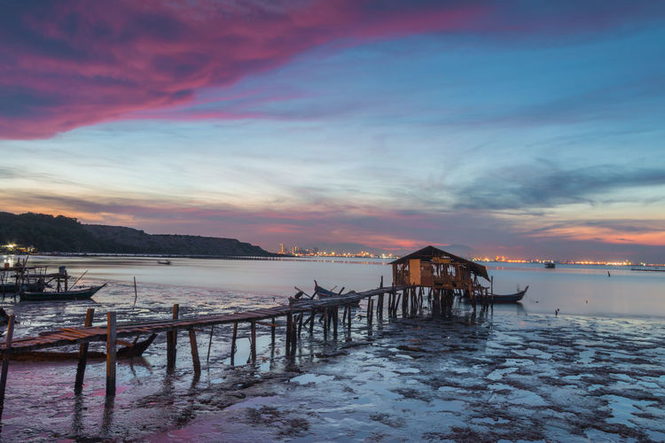 Sunrise at Penang island Sky Water Sunset Cloud - Sky Scenics - Nature Beauty In Nature Sea Built Structure Architecture Nature Tranquil Scene Tranquility Land Beach Pier No People Orange Color Nautical Vessel Outdoors Wooden Post