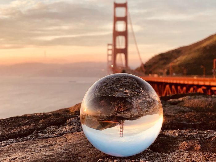 Lensball Sky Nature Sphere Water No People Cloud - Sky Land Close-up Sunset Reflection Focus On Foreground Beach Day Crystal Ball Transparent Glass - Material Outdoors Beauty In Nature Scenics - Nature Glass