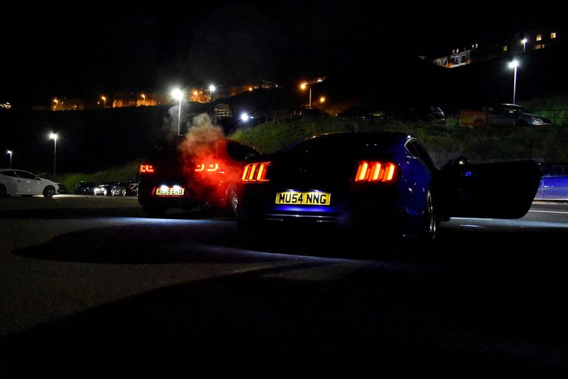 Illuminated Night Car Mode Of Transport Land Vehicle Transportation No People Architecture Built Structure Outdoors Building Exterior Sky City Car Photography Cars Ford Mustang GT Mustang Golf GTI Volkswagen