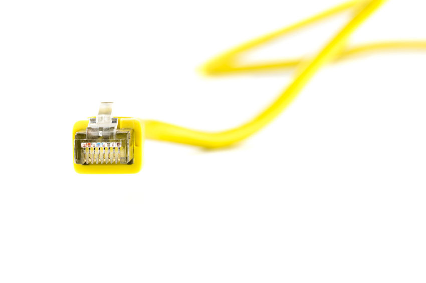 Ethernet Cable Bandwidth Cable Communication Computer Computer Cable Computer Network Connection Global Communications Information Medium Internet Network Connection Plug No People Technology White Background Yellow