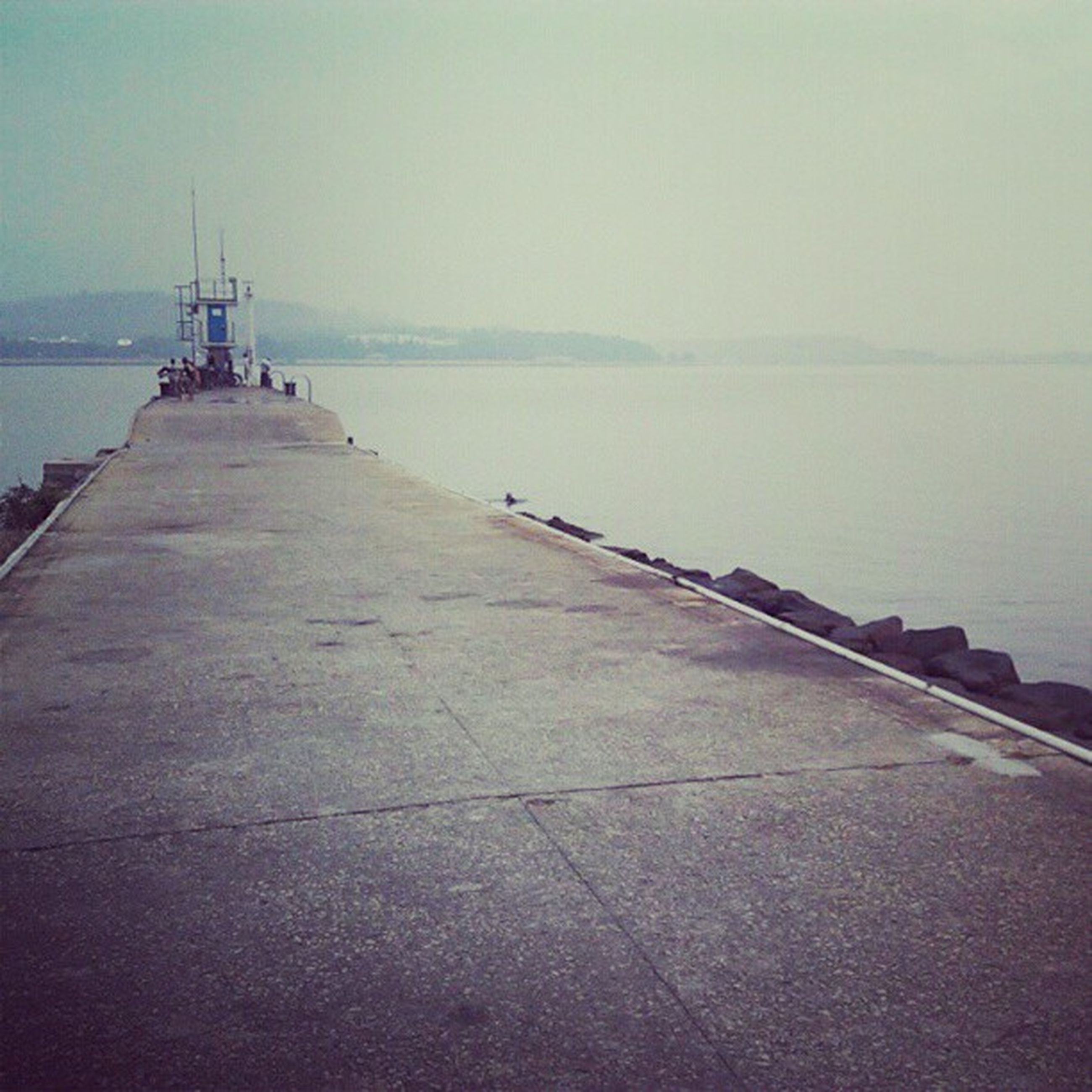 water, sea, clear sky, copy space, sky, built structure, pier, horizon over water, tranquility, the way forward, tranquil scene, transportation, nature, architecture, scenics, day, outdoors, nautical vessel, jetty, beauty in nature
