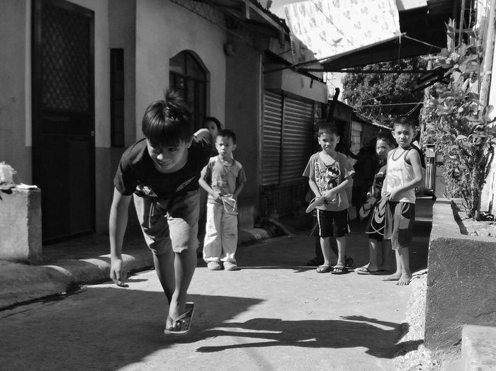 Mobilephotography Eyeem Philippines Blackandwhite Streetphotography Street Leisure Activity Child Childhood Playing Outside