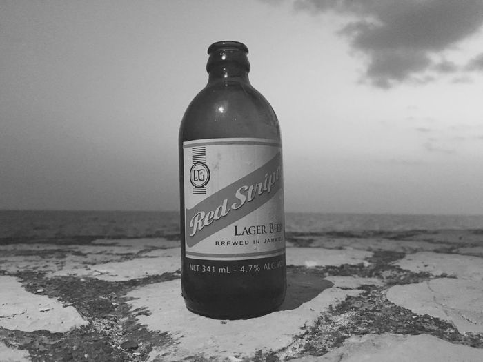 Jamaican nectar Beach Sea Nature Shore Sand Horizon Over Water Day Outdoors Water No People Sky Beer Red Stripe Beer Jamaica