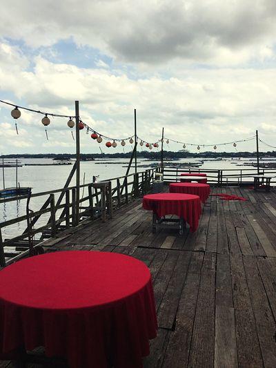 Malaysia Johor Bahru Empty Restaurant Outdoor Dining  Al Fresco Red Tablecloth Gray Sky