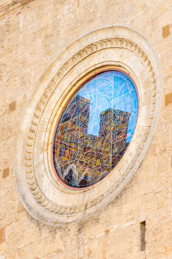 Reflection San Gimignano Tuscany Architecture Building Building Exterior Built Structure City Clock Day History Italy Low Angle View Nature No People Outdoors Place Of Worship Religion The Past Tower Travel Destinations Wall Wall - Building Feature Window