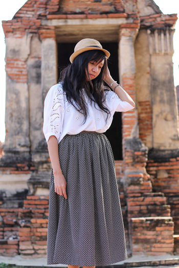 blissful traveler Wat Phra Mahathat Asian Girl Vintage Style Wat Phra Mahathat Peaceful Travel Lifestyle Travel Tourist Asian  Happiness Peace Travel Photography Dark Haired Woman Traveller Tourism Casual Clothing Fashion Beautiful Woman Beauty Portrait Smiling Females Standing Young Women Happiness Old Ruin Posing Historic Tourist Attraction  Famous Place Skirt