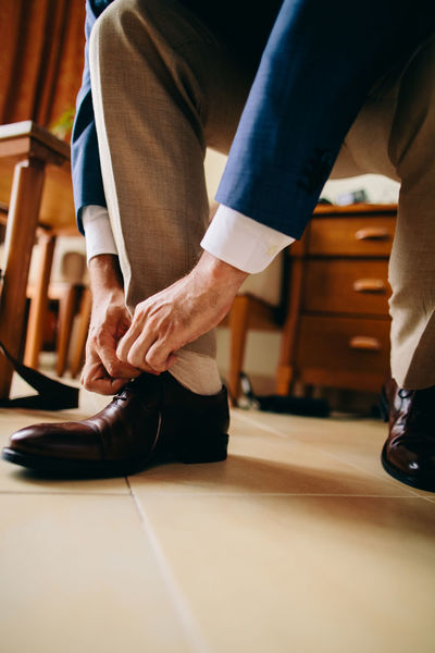 man wearing shoes EyeEm Best Shots Getting Ready Groom Groomsmen Man Shoes ♥ Suit Wearing Shoes Adult Clothes Day Hotel Human Body Part Human Leg Male Shoes Sitting Suits  Tie Watches Wearing Wearing Black