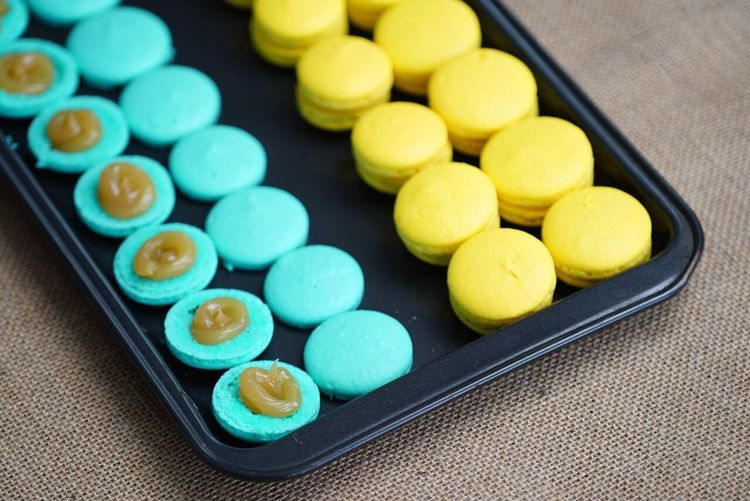 High angle view of macaroons in tray on table