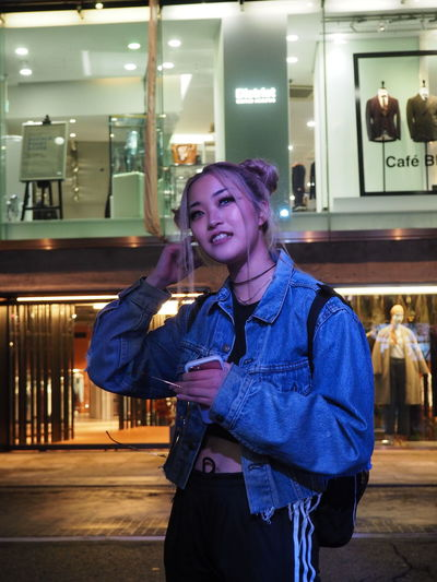 Asian Girl Casual Clothing Cool Fashion Front View Happiness Illuminated Japanese  Lifestyles Looking At Camera Millenial Neon Night One Person People Portrait Real People Smiling Standing Street Fashion Tokyo Street Photography Young Adult The Portraitist - 2017 EyeEm Awards