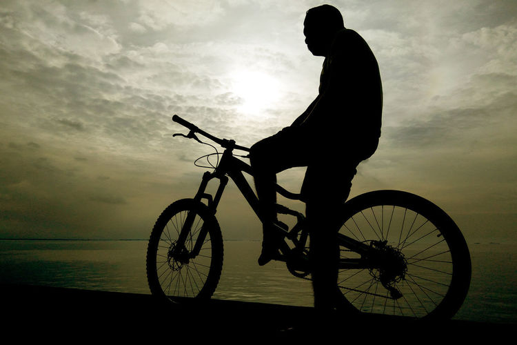 By The Seaside Watching The Sunset Bicycle Bicycle Silhouette Bmx Cycling Cloud - Sky Cycling Full Length Kulotitayclicks Land Vehicle Leisure Activity Man On Bike Man Silhouette Mobile Photography Mode Of Transport One Person Outdoors Riding Riding A Bike  Silhouette Sunset Transportation Xiaomi Redmi Note 3