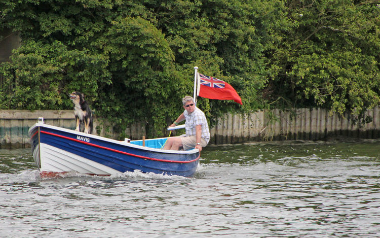 Man And Dog Adult Beauty In Nature Boatride Enjoying Life Flag Nautical Vessel One Person Outdoors River Themes Union Jack Flag Water
