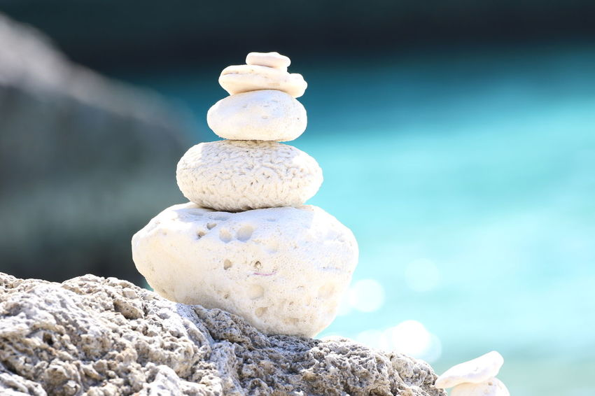 Balance Beauty In Nature Close-up Day Focus On Foreground Meditation Nature No People Outdoors Pebble Pile Of Stones Rock - Object Sea Stack Tranquility Water Zen-like