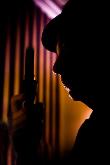 Close-Up Of Silhouette Man Holding Handgun