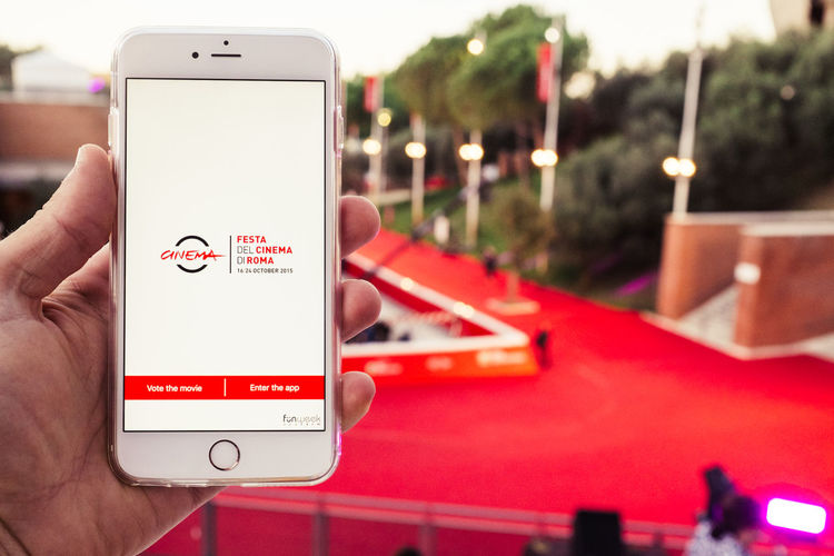 Rome film fest Cinema Close-up Communication Control Depth Of Field Focus On Foreground Fuji X100s FUJIFILM X100S Holding Information IPhone Large Group Of Objects Mobile Phone Photographing Photography Themes Red Carpet Rome Film Fest RomeFF10 Selective Focus Sign Smart Phone Technology VSCO Vscofilm X100S
