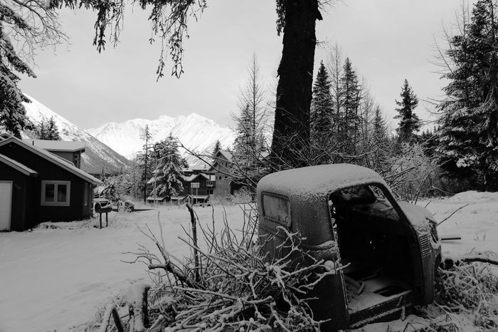 Girdwood, Alaska in December 2017. Black And White Friday Alaskan Nature Alaska Girdwood Blackandwhite Photography Black & White Black And White Blackandwhite Rusty Abandoned Car Neighborhood Snow Winter Cold Temperature House Built Structure Tree No People Nature Day Outdoors Frozen Mountain Sky