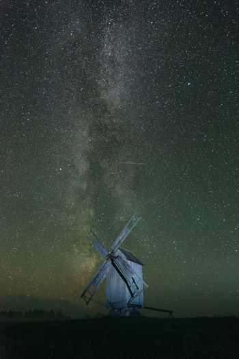 Traditional windmill against star field at night