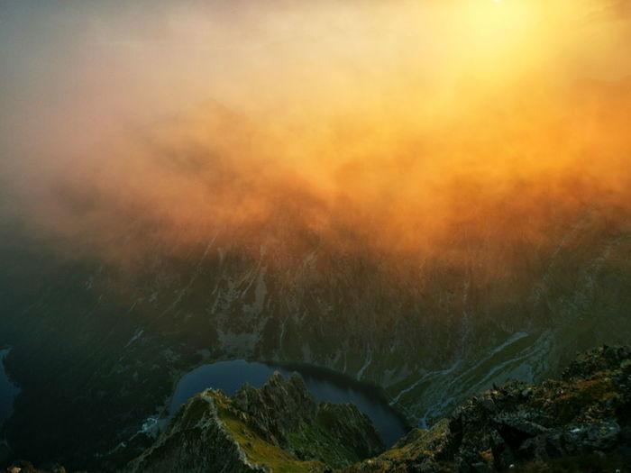 Hazy mountain peaks at sunrise. poland tatra mountains. red sunrise.